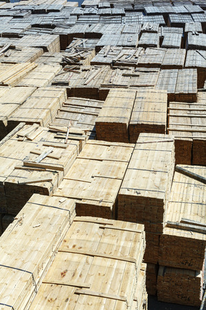 materiales de construccion: stacked piles of timber product at railroad cargo area