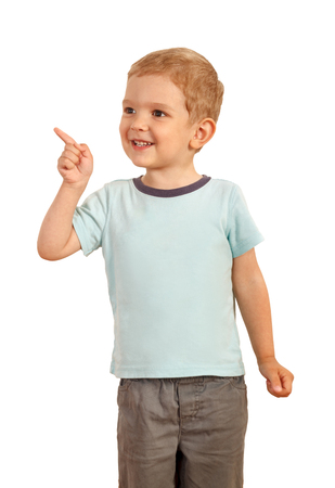 kid smile: blond boy pointing finger to the side. Isolated ower white