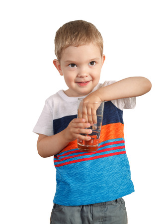 blond boy: blond toddler boy holding glass with ice water. isolated on white