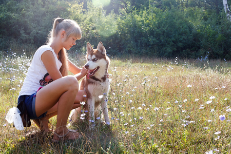 blondy: Young blondy woman with her huskey dog