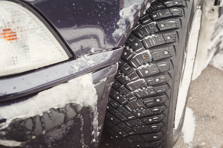 space weather tire: Winter driving conditions. Snow storm, snow tires, driving hazards Stock Photo