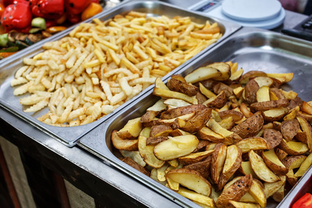 stile: Steel container with roasted potato wedges, country stile potatoes