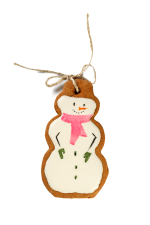 man made: Traditional Iced Gingerbread Christmas Cookies Snowmen Isolated on white Stock Photo
