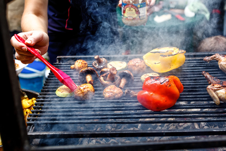 mushrooms and vegetables on the grill over low heat for preparing