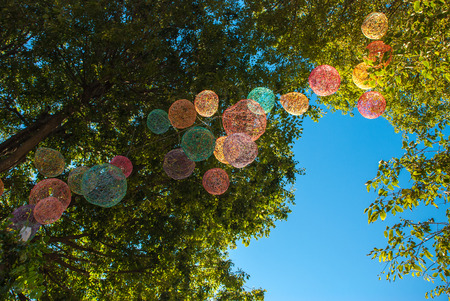 ramification: bright balloons in green branches Stock Photo