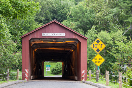 west river: WEST CORNVALL, CONNECTICUT - JULY 15, 2015: The 1864 West Cornwall Covered Bridge. also known as Hart Bridge, is a wooden lattice truss bridge over the Housatonic River on July 15, 2015 in West Cornwall, CT, USA. Editorial