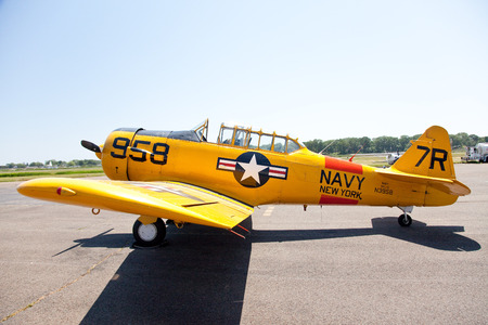texan: Stratford, USA - May 31, 2010: Yellow AT-6 Texan Trainer airplane during Wings & Wheels Memorial Day weekend parking on Sikorsky Memorial Airport. Editorial