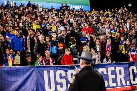 maximo: HARTFORD - OCTOBER 10:  Security issearching for men who run to field, give low five to Maximo Banguera and run back on US International Friendly match between US Men`s National Team vs Ecuador,  on October 10, 2014, in Rentschler Field stadium, Hartford,
