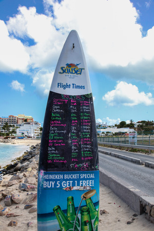MAHO BAY BEACH  AUGUST 01: Maho Bay Beach view with Fligh Times board from Sunset Bar and Grill seen in St.MartinSt.Maarten on August 1, 2015