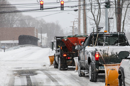 NORWALK,NORWALK, CT - JANUARY 27, 2015:  Snow plow cars line on North Taylor Ave after winter storm in Norwalk