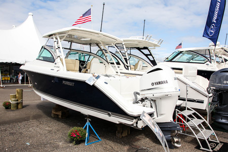NORWALK, CT, USA-SEPTEMBER 20, 2018: Pursuit DC 235 displayed on  Progressive Norwalk Boat Show 2018.