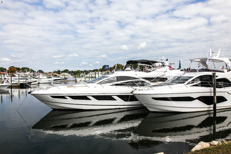 NORWALK, CT, USA-SEPTEMBER 20, 2018: Boats docking and displayed on  Progressive Norwalk Boat Show 2018.