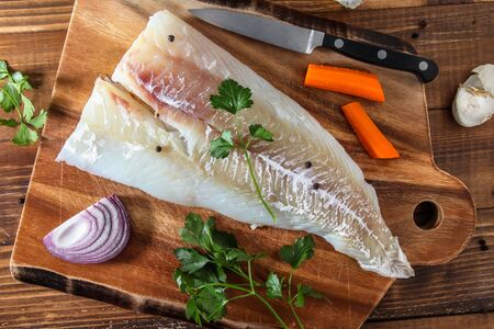 Alaskan cod fillet on cutting board