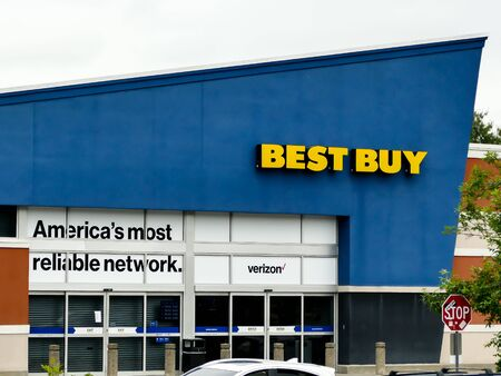 NORWALK, CT, USA - JUNE 9, 2019: Best Buy electronic retailer store store sign  on store facade on Connecticut Ave.