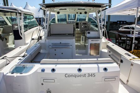 NORWALK, CT, USA - SEPTEMBER 19, 2019:   New 2019 Conquest 345 shoving on Progressive Norwalk Boat Show Day 1 From September 19-22, 2019. 報道画像