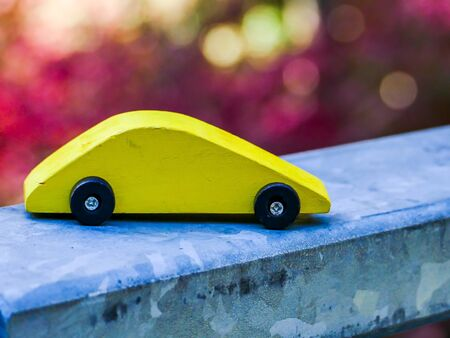Yelloe wooden toy car with seasonal colors 写真素材