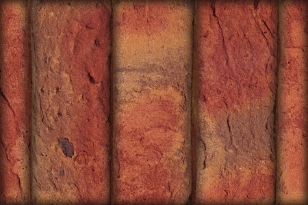 background from  red rough bricks put vertical photo