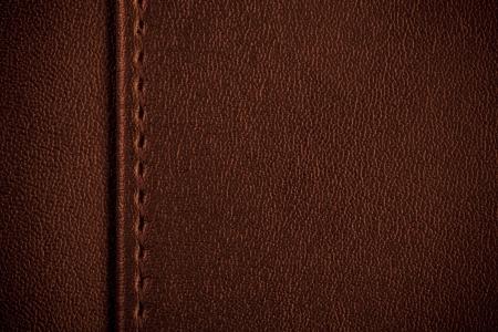 margine: struttura di cuoio marrone, cucitura tra il margine e lo sfondo Archivio Fotografico