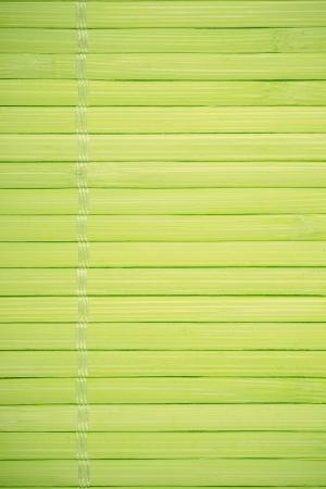 margen: verde, palitos de madera de fondo hilo, entre el margen y el fondo Foto de archivo