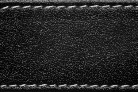 black leather texture: black leather background with white thread seam