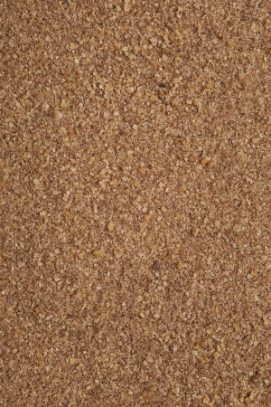 aniseed: ground anise background, brown grain powder backdrop Stock Photo
