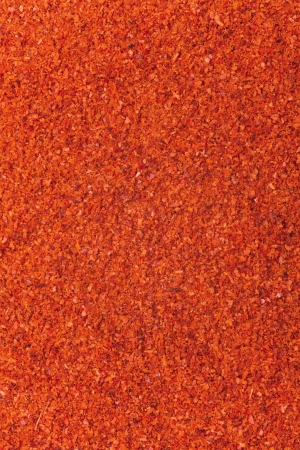 red chilli powder background, abstract organic texture
