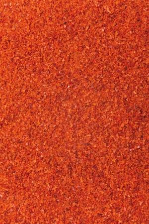 rode chilipoeder achtergrond, abstracte organische textuur Stockfoto