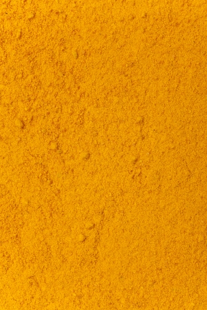 turmeric powder background, yellow grain abstract texture