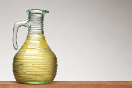 bottle of vegetable oil on white background