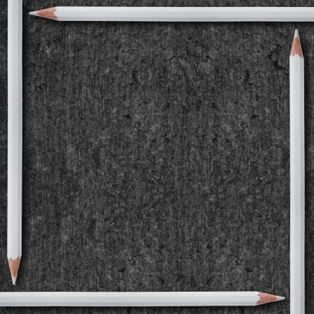 white pencils on black background or rough grey texture Stock Photo - 17552100