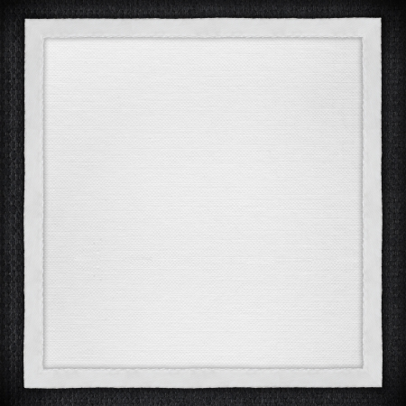 White Paper Background In White Canvas Frame On Black Textile ...