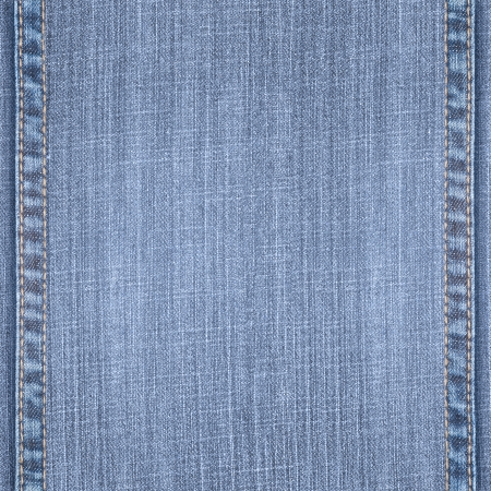 blue jeans background with seams or canvas rough texture