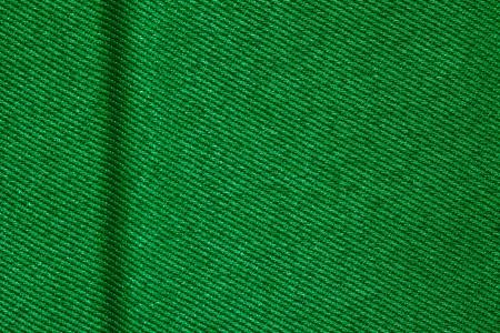 margen: tela de fondo verde con margen en el lado izquierdo o textura textil tejido