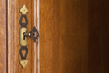wooden background with doorplate and key on left side photo