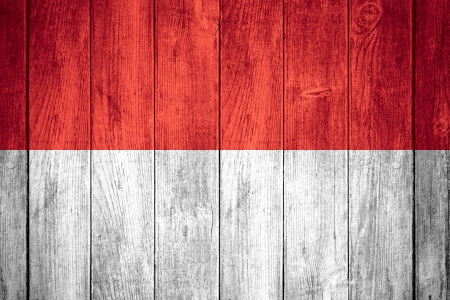indonesian flag: flag of Indonesia or red and white Indonesian banner on wooden background