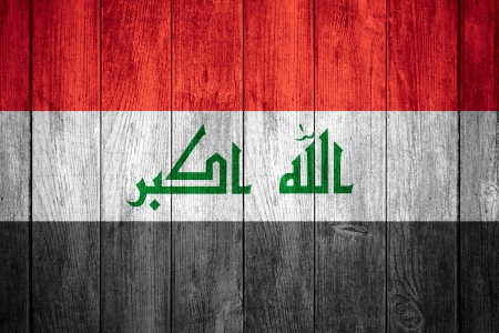 iraqi: flag of Iraq or white, red, white, green and black Iraqi  banner on wooden background Stock Photo