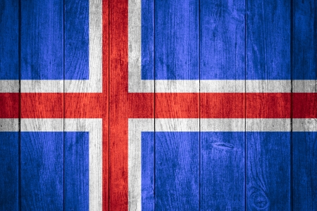 the icelandic flag: flag of Iceland or white, blue and red Icelandic  banner on wooden background Stock Photo