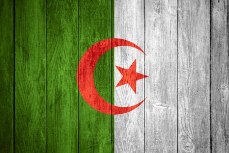 flag of Algeria or white, green, red and white Algerian  banner on wooden background photo