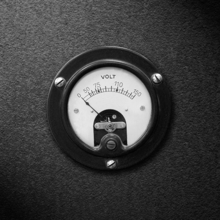 voltmeter: old voltmeter on black metal rough pattern texture or vintage electric measurement Stock Photo