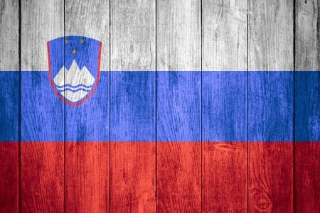 slovenian: flag of Slovenia or Slovenian banner on wooden background