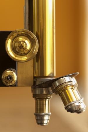 scientific equipment: closeup of old microscope lenses or vintage scientific equipment Stock Photo