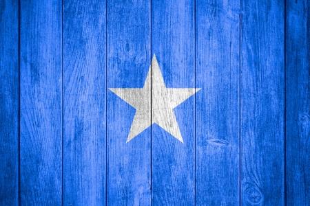 somali: flag of Somalia or Somali banner on wooden background