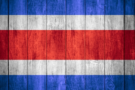 middle america: flag of Costa Rica or Corsican banner on wooden background