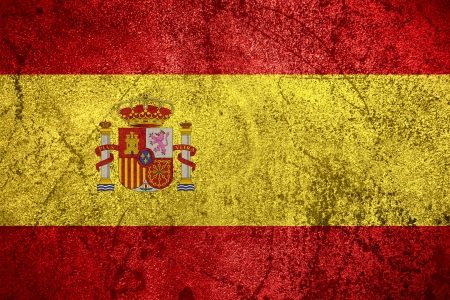 flag of Spain or Spanish banner on rough metal background photo