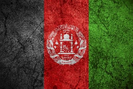 afghan flag: flag of Afghanistan or Afghan banner on rough metal background
