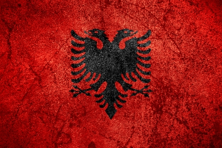 flag of Albania or Albanian banner on rough metal background photo