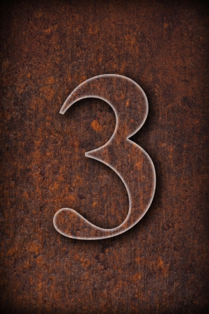 three number on rusty iron brown background  photo