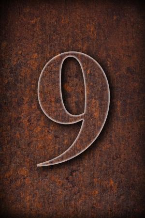 number nine: el n�mero nueve en fondo marr�n oxidado hierro Foto de archivo