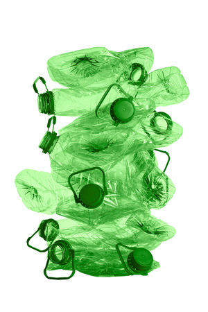 recycling or stack of green plastic bottles isolated on white background photo