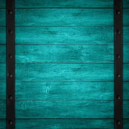 turquoise wooden background with black metal border or wood grain blue texture photo